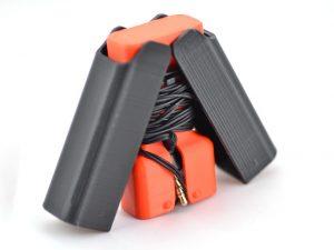 Earbud holder by sneakypoo